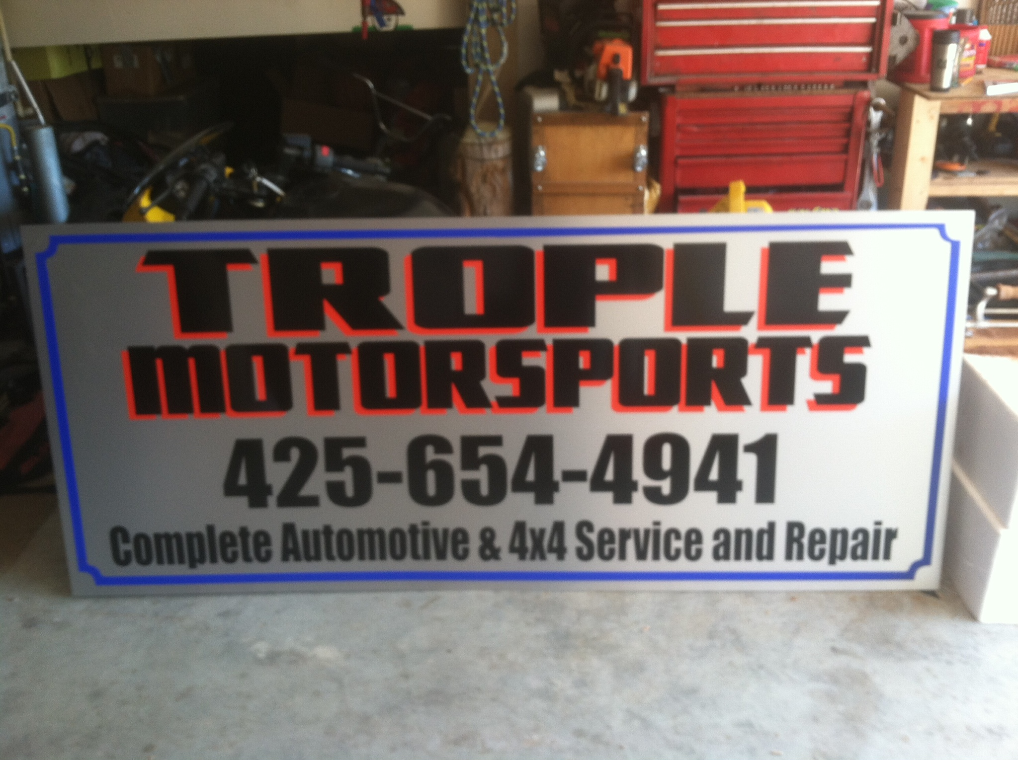 die-cut graphics on brushed metal alupanel for Trople Motorsports of Everett, wa