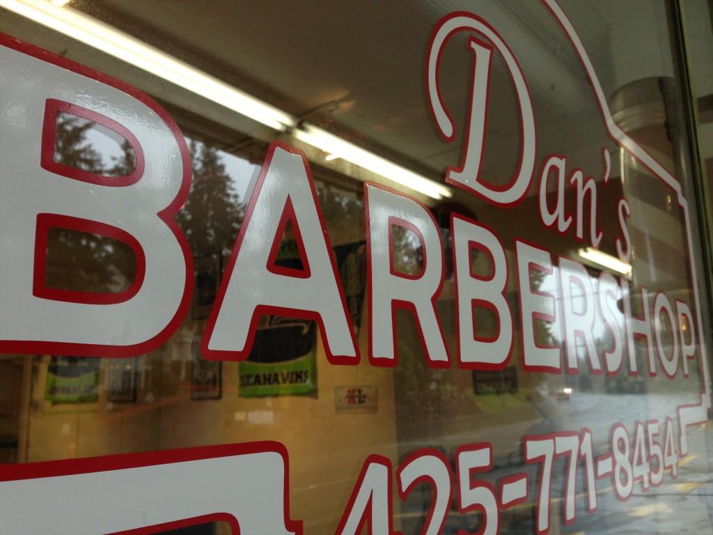 Custom vinyl window graphics for Dan's Barber Shop of Edmonds, WA
