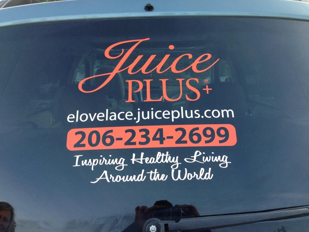 Two color custom vinyl window graphics for Juice Plus of Mill Creek, Washington