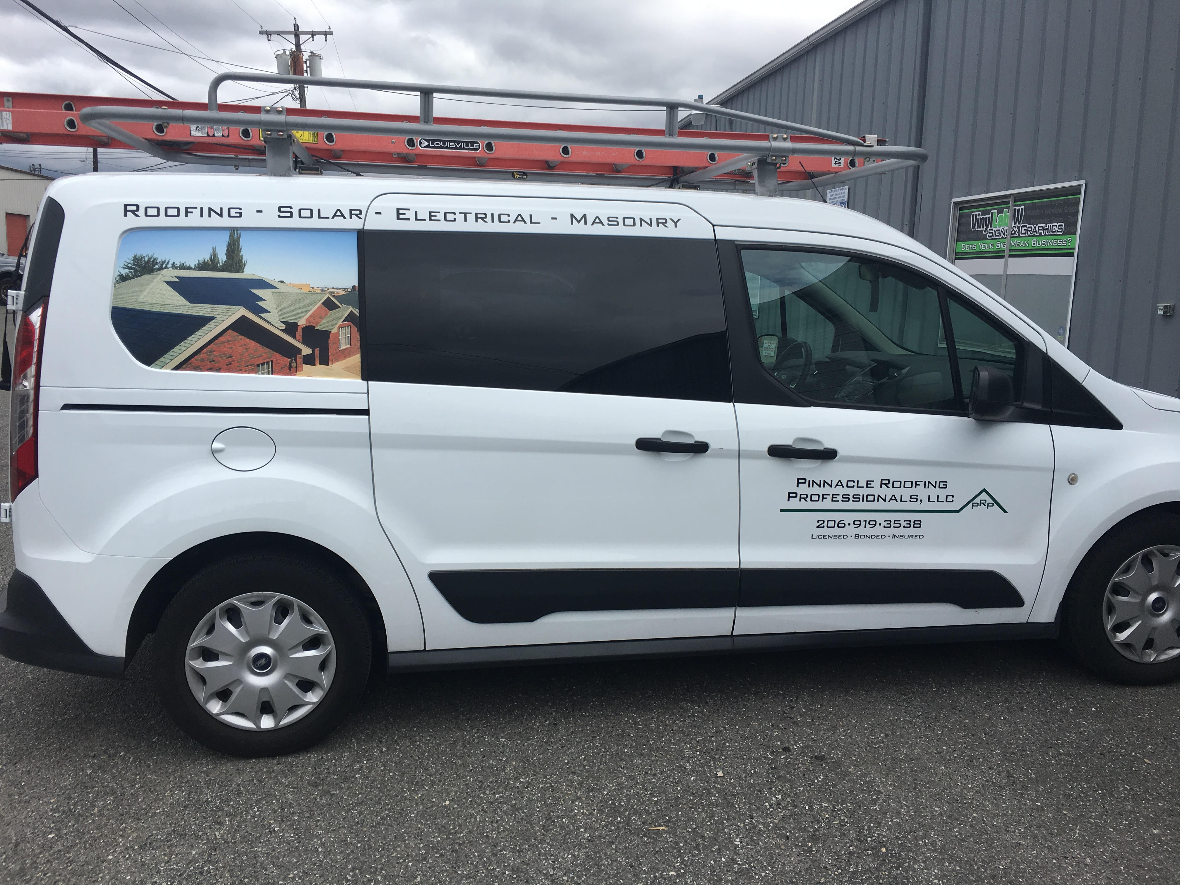 Ford Transit Graphics for Pinnacle Roofing Pros of Lynnwood